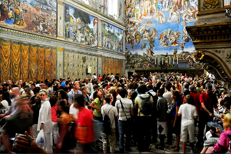 Visitors inside the Sistine Chapel